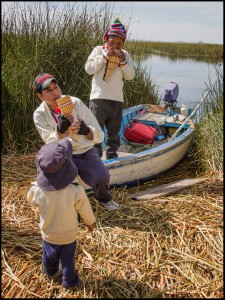 Boys playing pan pipes Lake Titicaca